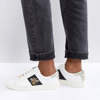 Dune London Ebie Bee Embellished Trainers at asos.com