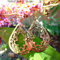 Morrocan Gold shiny Large design teardrop hoops with gold ear wire.