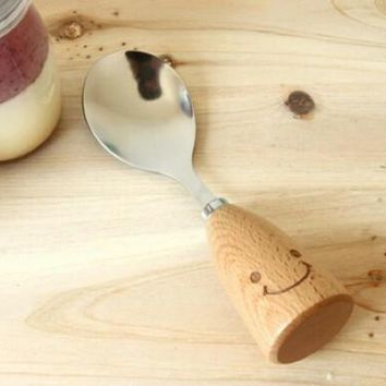 wood smiling face spoons 2