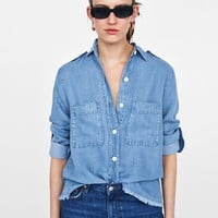 LOOSE-FITTING SHIRT WITH POCKETSDETAILS