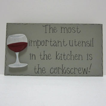 "Hand Painted Wooden Gray Funny Wine Sign, ""The most important utensil in the kitchen is the corkscrew."""