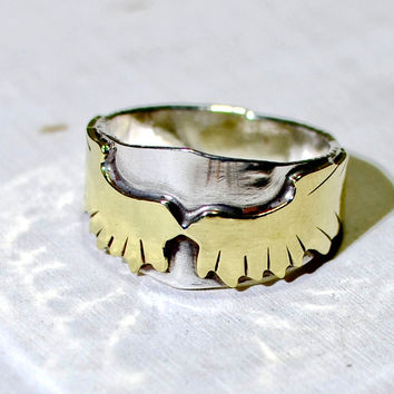 Soaring brass wings on sterling silver artistic asymmetrical ring