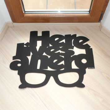 "Door mat ""Here lives a nerd"" and a glasses. Funny welcome mat"