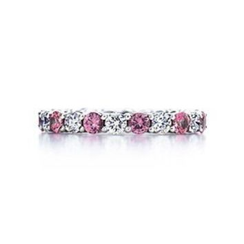 Tiffany & Co. -  Shared-setting band ring of pink sapphires and diamonds in platinum.