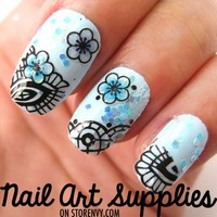 Feather and Flower Nail Art Decal Salon Effect from nailartsupplies