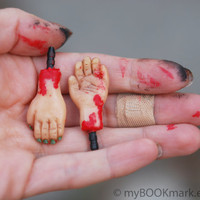 Set of 2 Zombie hands . Earphone  dustplugs. Miniature bloody anti valentine plug.  Fits 3.5mm output. turquoise, black, dirty