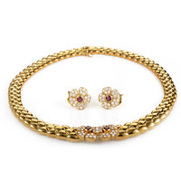 Van Cleef & Arpels Ruby Diamond Yellow Gold Floral Jewelry Set