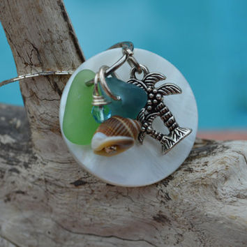 Island Treasure necklace is adorned with a mother of pearl shell, authentic  sea glass, swarovski crystals, shells, & palm tree charm,beachy