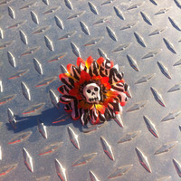 Zebra and orange gerber flower hair clip with skeleton
