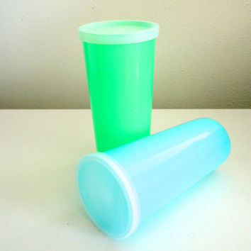 Vintage Tupperware cups with lids or tall snack containers in blue and green pastel 1960s colors