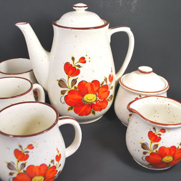 Teapot with cups sugar and milk jug , Set for tea or coffee in sandstone with orange flowers