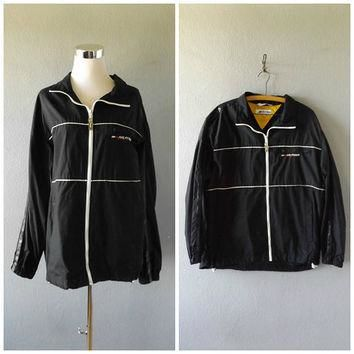 tommy hilfiger windbreaker jacket | vintage 90s black nylon sporty athletic coat men s