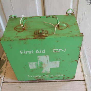 Vintage collectible railroad medical first aid box, industrial retro green rusty metal storage