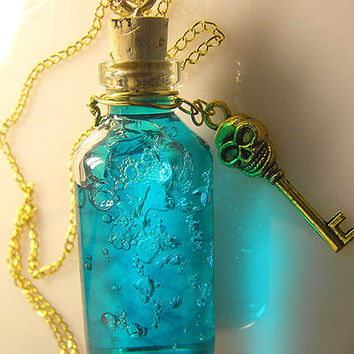 Ocean's Secret Teal Vial Necklace Skull Key Gold by esanany