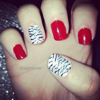 Red and glitter zebra print design on false nails by MadeByMace