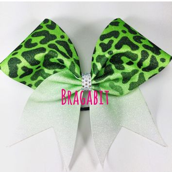 Fading cheetah bow with AB rhinestones center. Can be made in any color. Matching keychain can be added for extra charge.