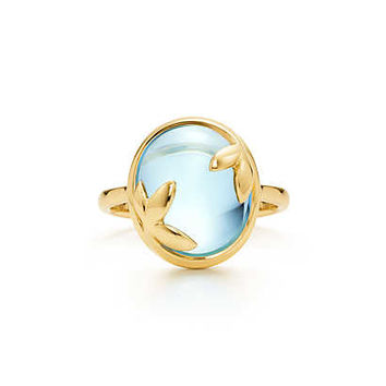 Tiffany & Co. - Paloma Picasso® Olive Leaf ring in 18k gold with a blue topaz.