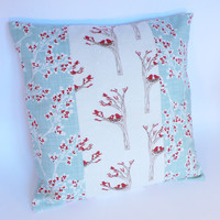 Winter cushion cover pillowcase with birds on branches and snow. Christmas