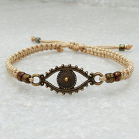 Evil eye protection bracelet with brown beads and adjustable closure, hand knotted boho style bracelet