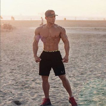 Fashion Men Muscle Gyms Shorts Bodybuilding Cotton Lenght Pants Casual FitnessTrousers Fashion Brand Runner Short Pants DXM24