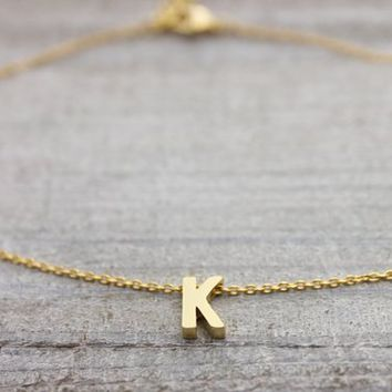 Custom upper case initial gold bracelet with an adjustable extension chain
