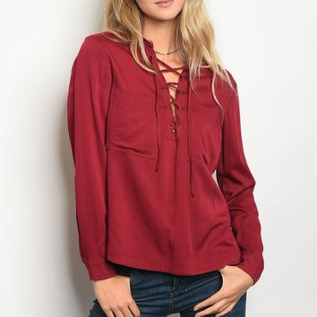 Ladies Long Sleeve Relaxed Fit Top With A Lace Up V Neckline