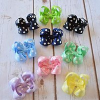 Polka dot 3 inch hair bows on an alligator clip, snap clip or barrette with a no slip grip. Perfect for babies, toddler and girls.