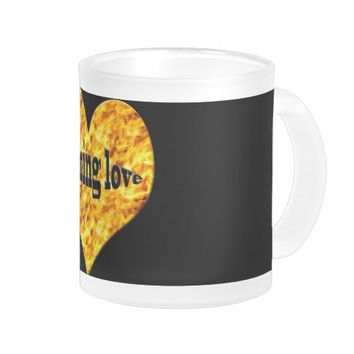 Heart on fire, decorates this frosted mug.