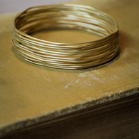 Stack of Bracelets in Matte Gold