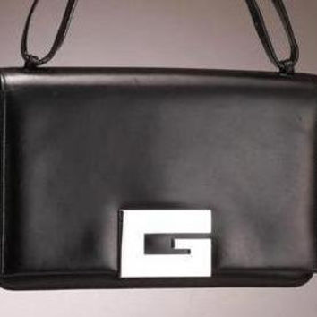 SALE Vintage Gucci black leather purse with a large G mark metal charm.