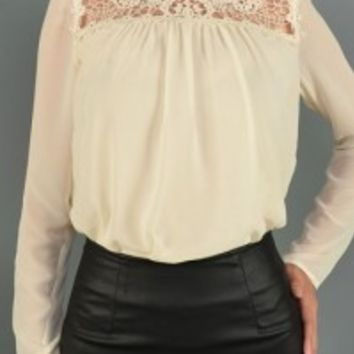 Make room in your closet because you totally need crochet mocked turtleneck chiffon top. Did we mention all white is the best way to enjoy every season? This semi-sheer flawy chiffon top has semi-sheer crochet neckline, with a back buttons closure. Fully l