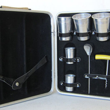 Vintage Mid Century Travel Bar. drinking glasses and liquor bottles. black carrying case for 4