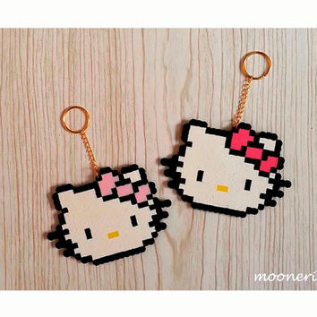 set of 2 pixel art plastic hand made hello kitty key chains, bag accessory, charm
