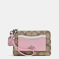 Corner Zip Wristlet in Colorblock Signature Coated Canvas