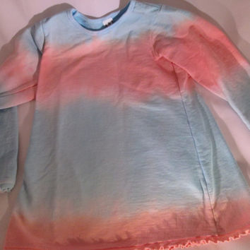 Easy-to-wear pretty Size 8 girls, Peach, blue,  long sleeve shirt, French Terry, ruffle edges at sleeves and hem.