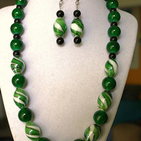 Green glass beads. Necklace and earrings set