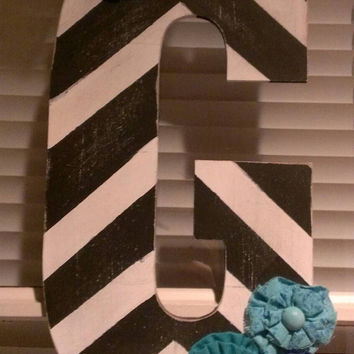 Black and white distressed chevron initial door hanger with blue flowers