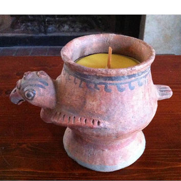 Pure yellow Beeswax candle, slightly scented with Lemon Grass essential oil, in a pre-Columbia n style decorated clay chicken.