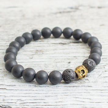 Matte black onyx and lava stone beaded stretchy bracelet with gold skull, custom made yoga bracelet, mens bracelet, womens bracelet