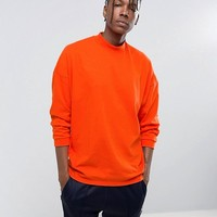 ASOS Oversized T-Shirt With High Neck And Cropped Arm In Red at asos.com