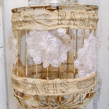 Rusty birdcage hanging lamp swag lace doilies distressed French tea stained muslin ribbon Edison style light bulb Anita Spero