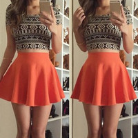 Black Floral Print Short Sleeves T Shirt with Orange High-Waisted Skirt