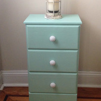 Small green bedside table