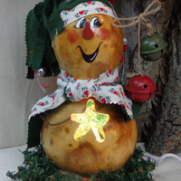 Hand crafted lighted gourd art snowman with green scarf and hat by Debbie Easley