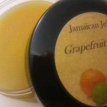 Jamaican Jelly styling pomade with JBCO & Candelilla Wax; Create sleek or wavy style. Non-Petroleum Jelly and Pomade