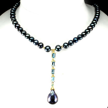 A Vintage Tahitian Black Pearl and Emerald Cut Swiss Blue Topaz Necklace