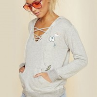 LACE UP HOODIE WITH PATCHES