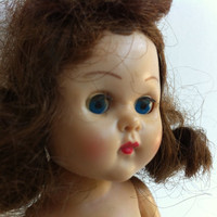 Vintage 1950's Ginny walker doll. Curly brown hair and sleepy eyes Missing a leg