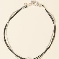 BLACK STRING AND SILVER CHAIN BRACELET WITH AN OPEN SQUARE CHARM