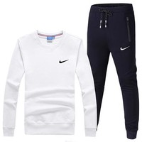 NIKE 2018 autumn new thin round neck long-sleeved T-shirt running sportswear two-piece White
